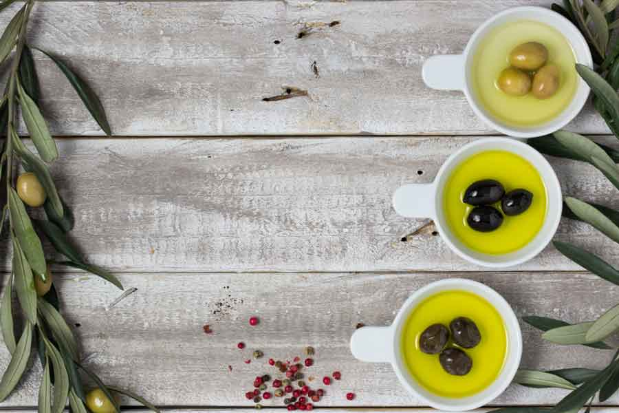 olives in cups with olive oil